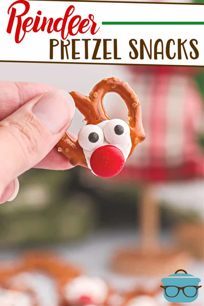Reindeer Pretzel Christmas Snacks recipe from The Country Cook, one pretzel being shown held by a hand