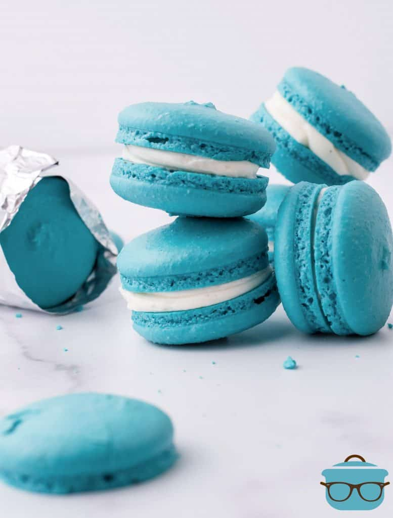 Teal Blue Macarons, stacked on a marble surface, Space Macaron, cookies eaten by Baby Yoda in the Mandalorian