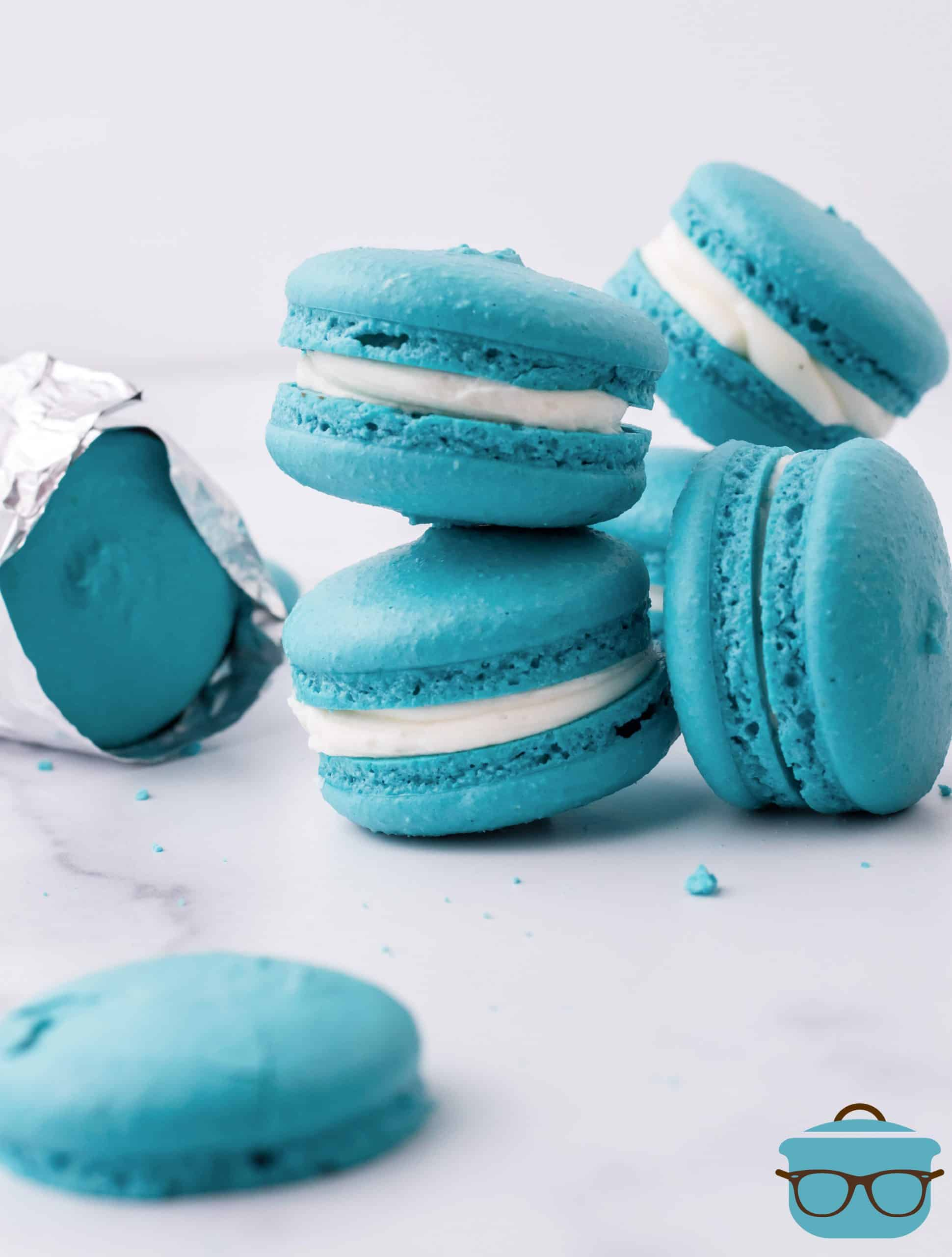 Teal Blue Macarons, stacked on a marble surface, Space Macaron, cookies eaten by Baby Yoda in the Mandalorian.