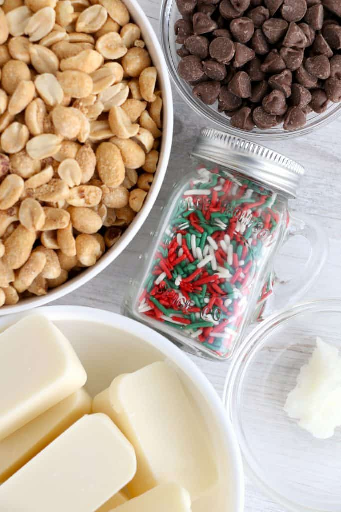 20 oz vanilla almond bark 16 oz salted, roasted peanuts ⅓ cup milk chocolate chips 1 tsp coconut oil sprinkles