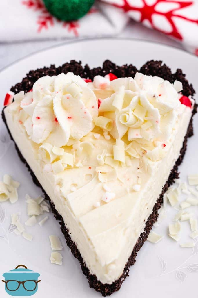 White Chocolate Peppermint Pie, slice on a white plate with white chocolate shavings