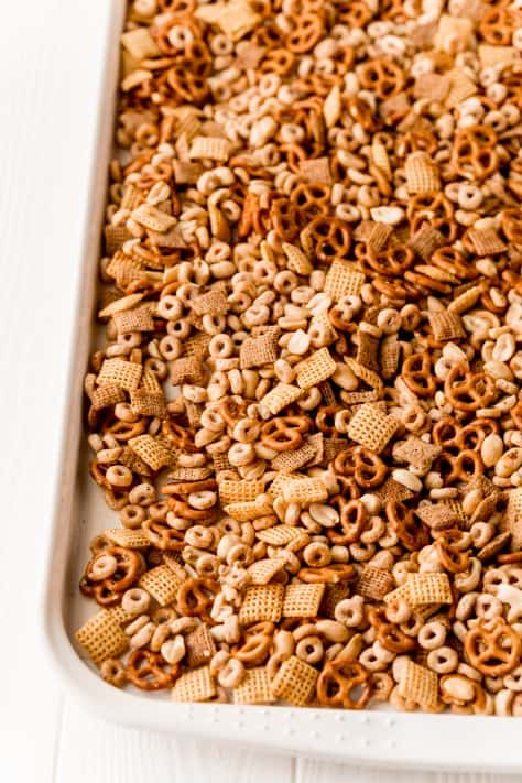 The Best Party Chex Mix spread out onto baking pan