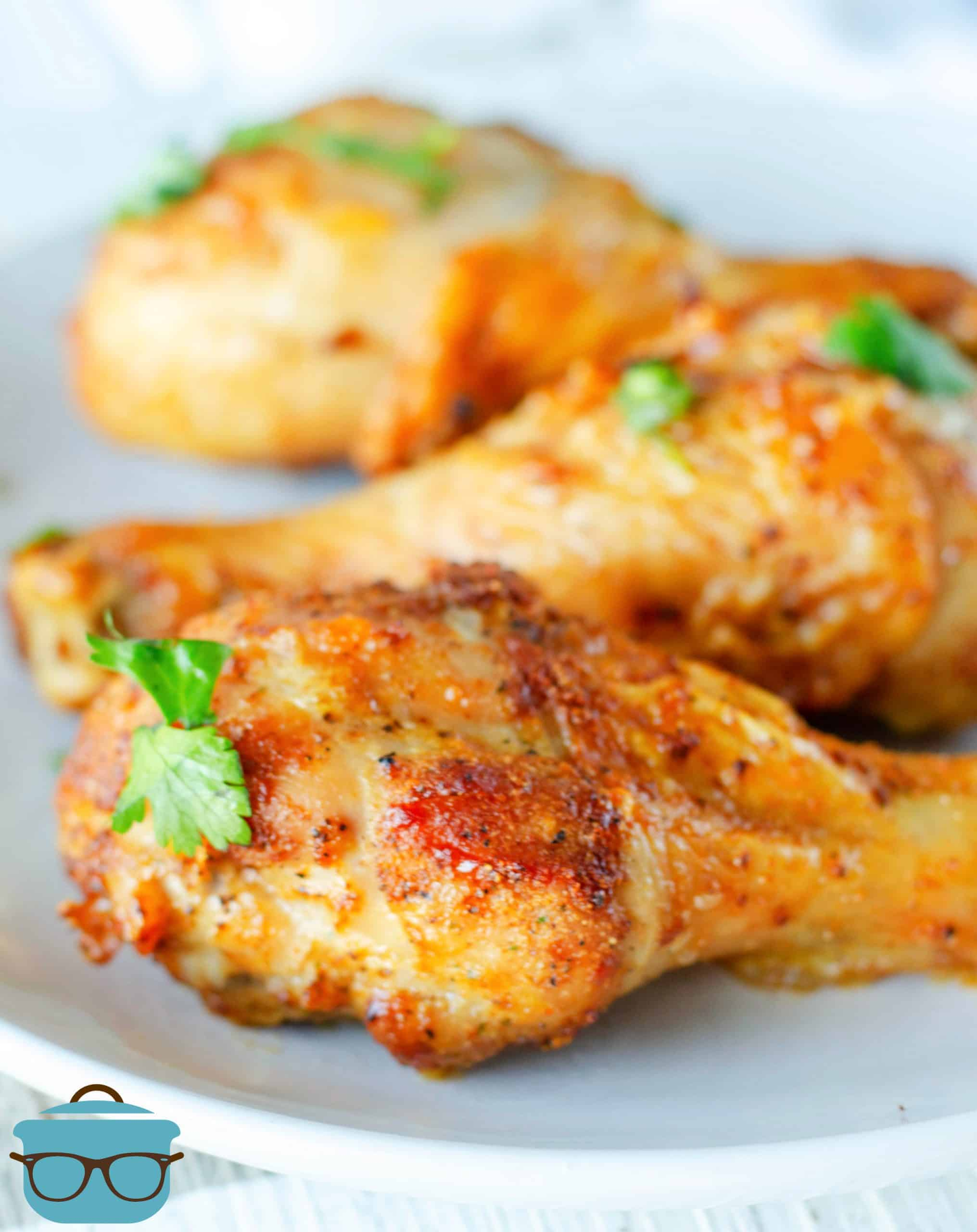 Close up side view of Air Fryer Drumsticks on white plate