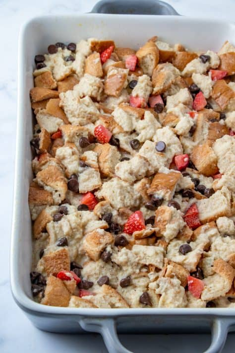 Chocolate Covered Strawberry Bread Pudding mixture poured into baking pan
