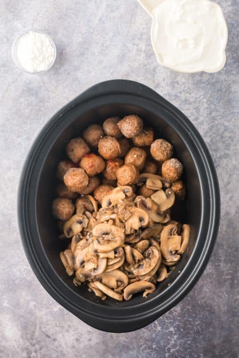 Frozen meatballs and mushroom and onion mixture added to crock pot