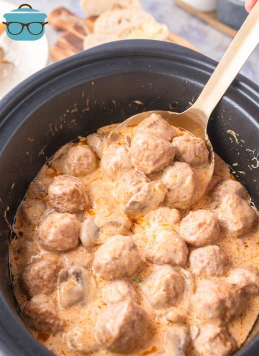 Finished Crock Pot Meatball Stroganoff in Crock Pot with spoon