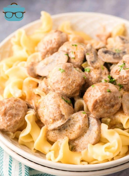 Close up of Crock Pot Meatball Stroganoff over egg noodles in bowl