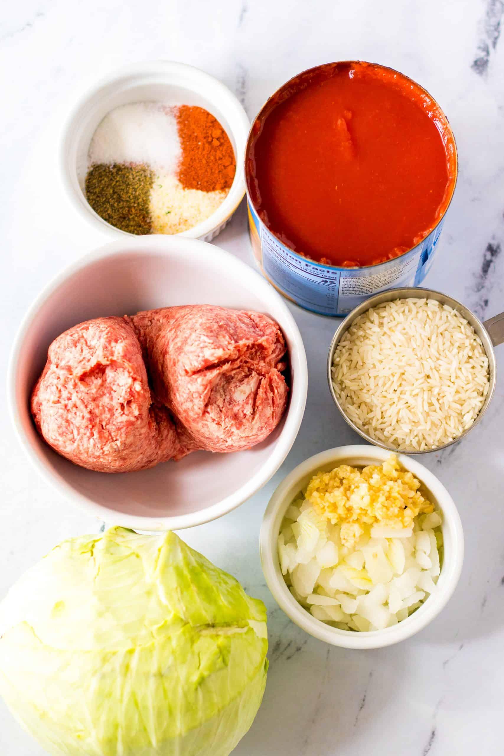 Ingredients need to make Crock Pot Unstuffed Cabbage Rolls: ground beef, garlic, onion, cabbage, water, white rice, pepper, garlic salt, paprika, sugar, tomato sauce.