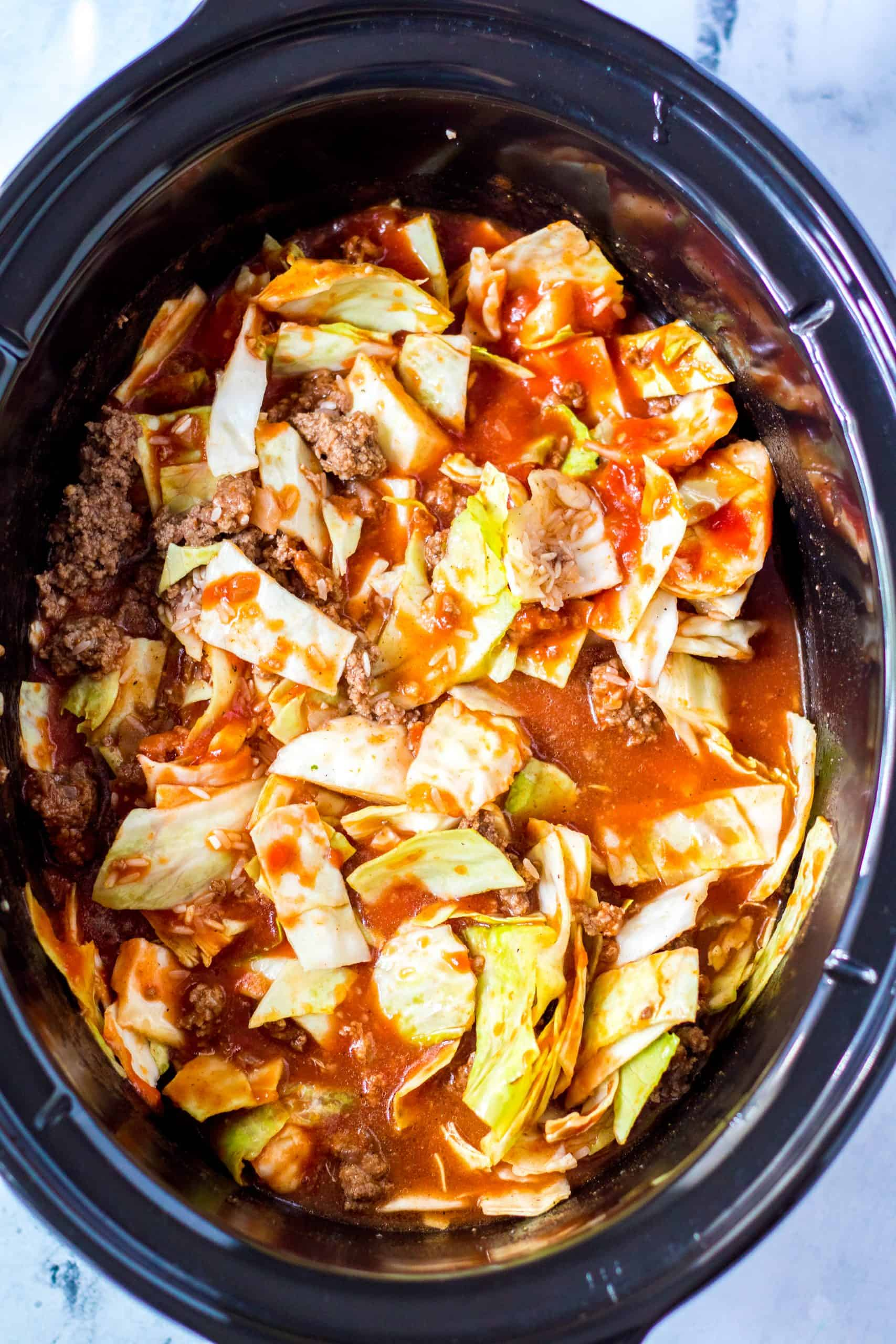 Cabbage added to crock pot and stirred along with other ingredients.