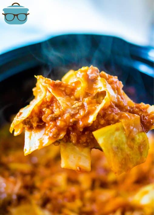 Serving spoon holding up portion of Crock Pot Unstuffed Cabbage Rolls