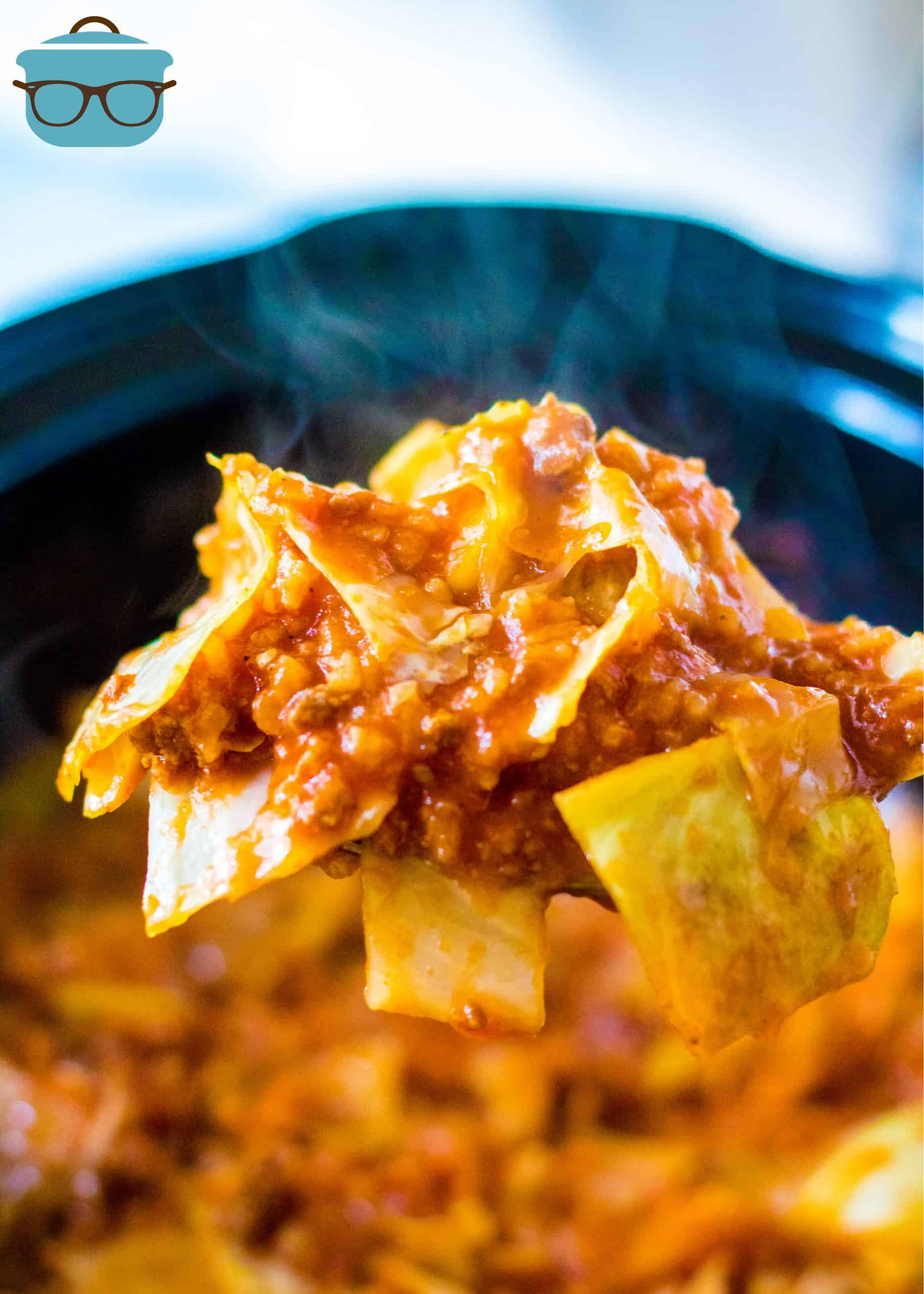 Serving spoon holding up portion of Crock Pot Unstuffed Cabbage Rolls.