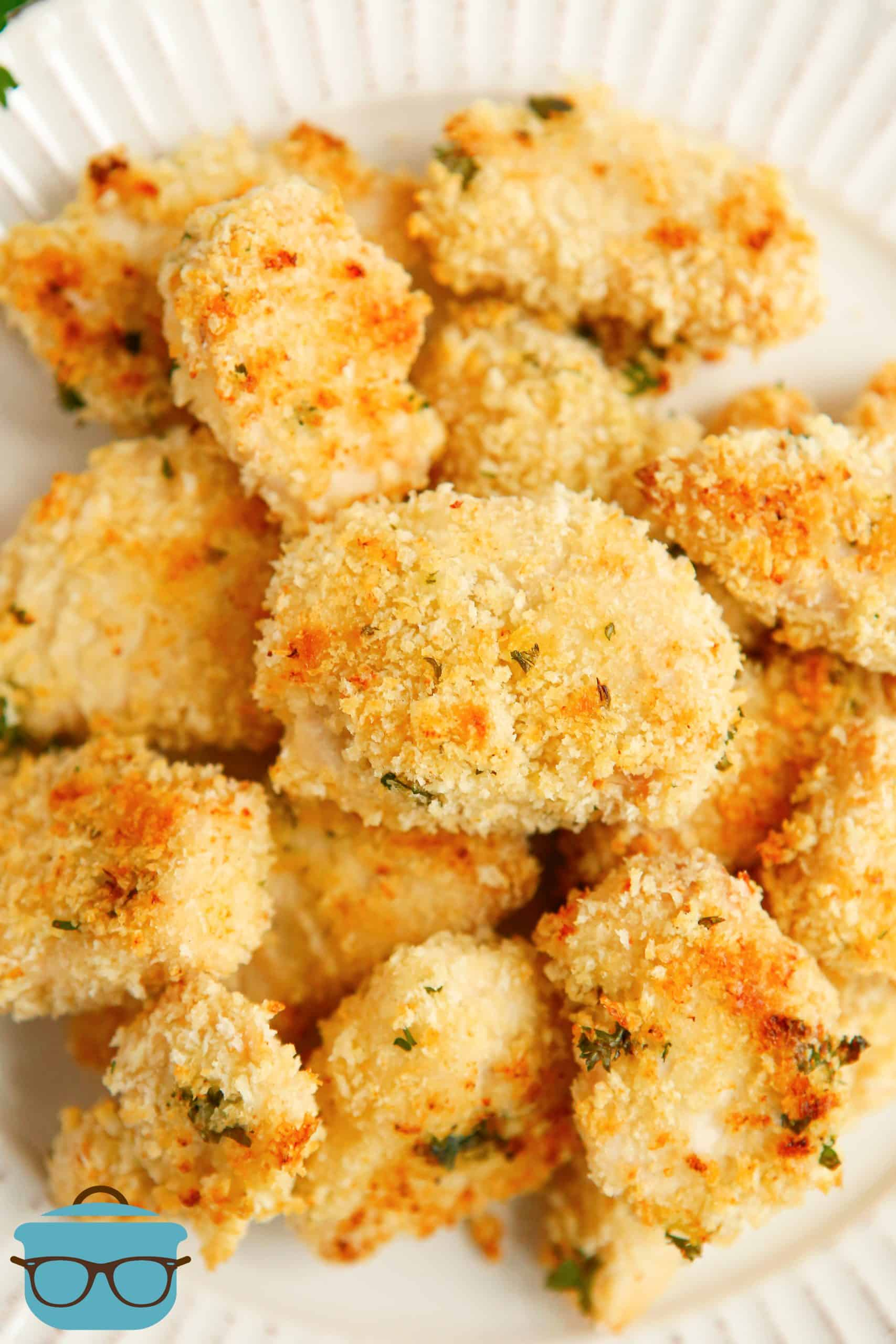 Closeup of stacked Ranch Chicken Nuggets on a white plate.