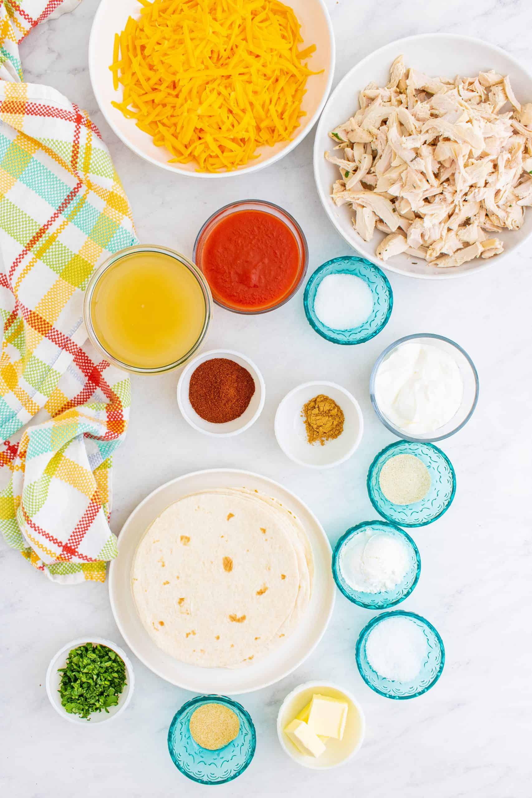 butter, chili powder, garlic powder, onion powder, ground cumin, cornstarch, chicken stock, tomato sauce, granulated sugar, kosher salt, shredded cooked chicken, shredded cheddar cheese, sour cream, fresh cilantro, flour tortillas.