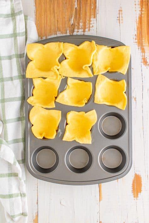Quadrados de massa crescente em forma de muffin