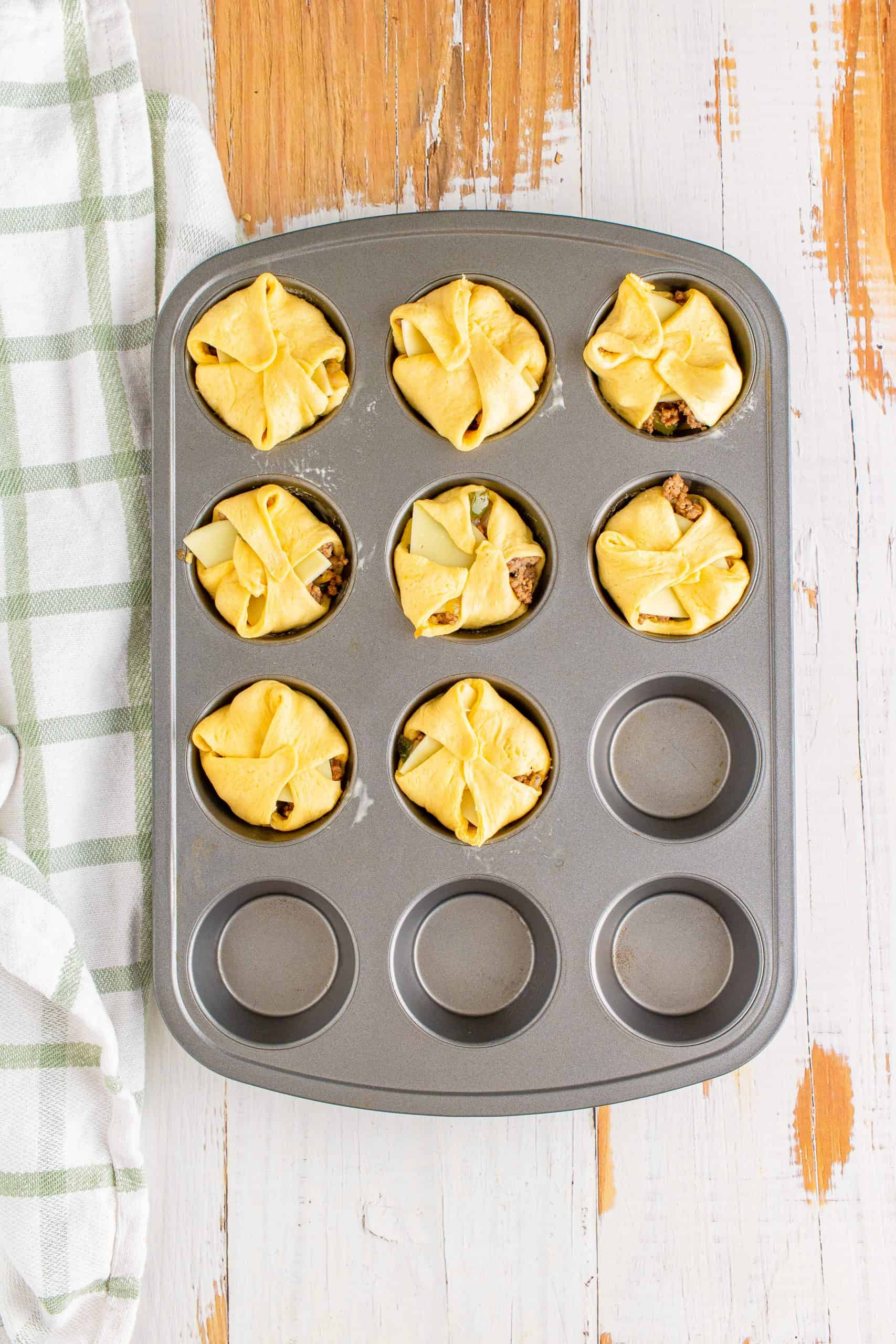 Crescent squares sealed together in muffin tin.