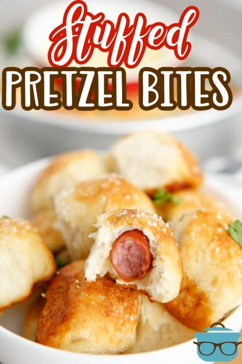 Stacked Stuffed Pretzel Bites in bowl with one with bite taken out