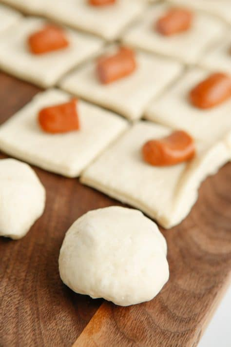 Pretzel Bites being rolled into dough
