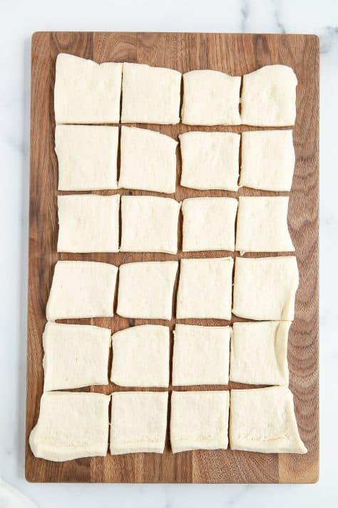 Pizza dough on cutting board cut