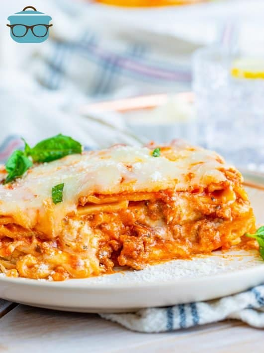 Homemade Baked Lasagna Recipe slice on white plate