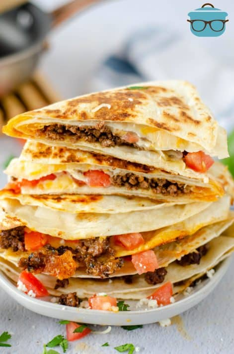 Stacked Taco Quesadillas cut open on white plate