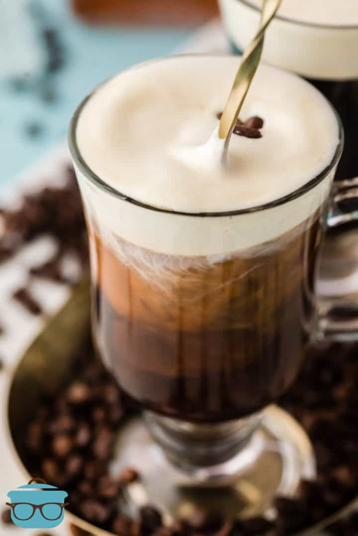 Old-Fashioned Irish Coffee on plater with stirring spoon in mug