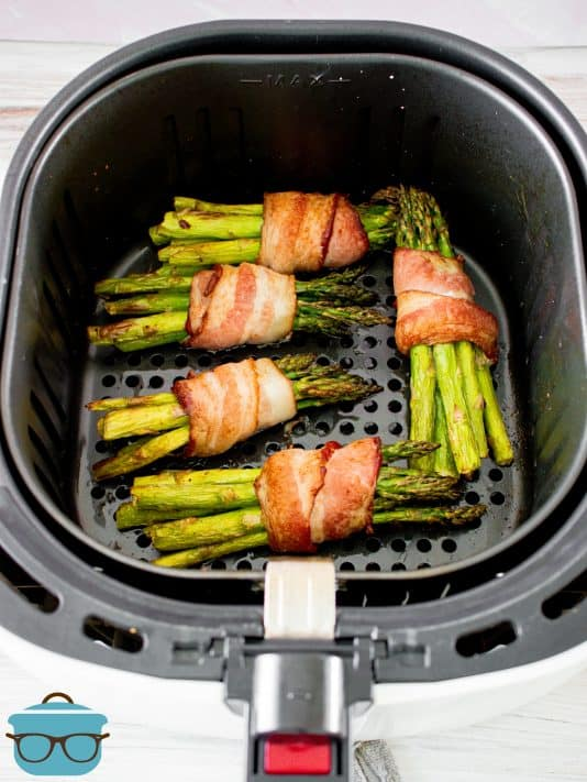 Finished Air Fryer Bacon Wrapped Asparagus in air fryer