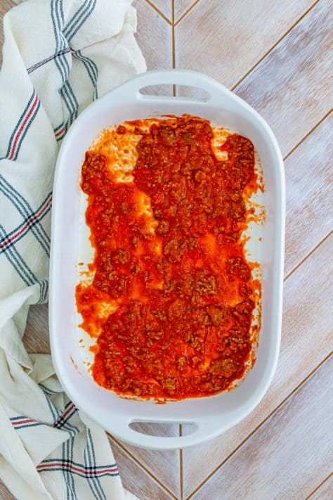 Meat sauce added to bottom of baking dish