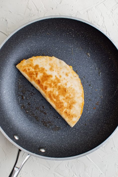 Browned finished quesadilla in pan