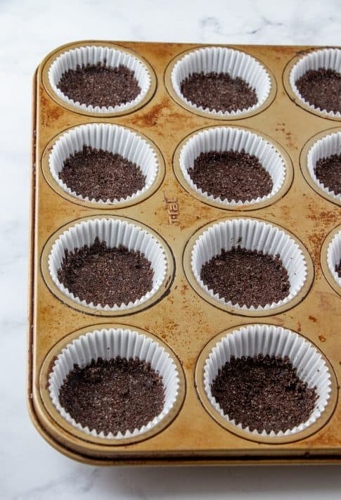 Crust mixture pressed into bottom of liners in muffin tin