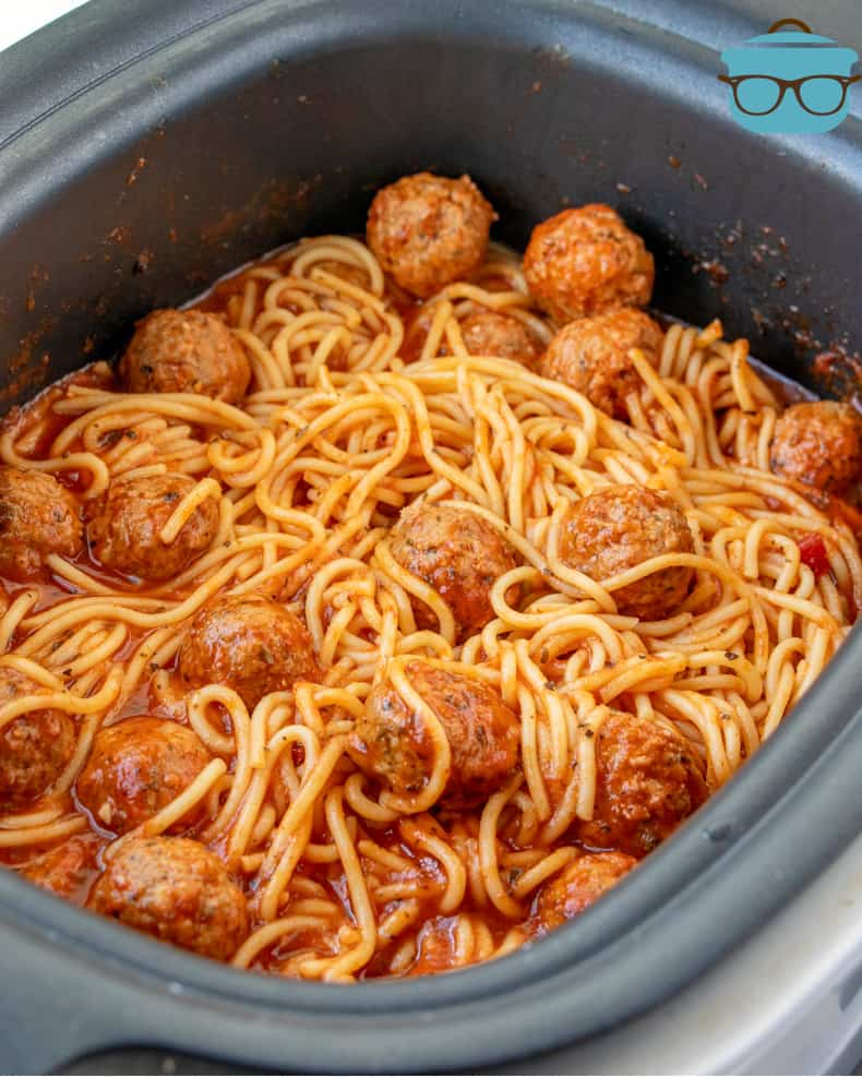cooked spaghetti and meatballs shown in the slow cooker
