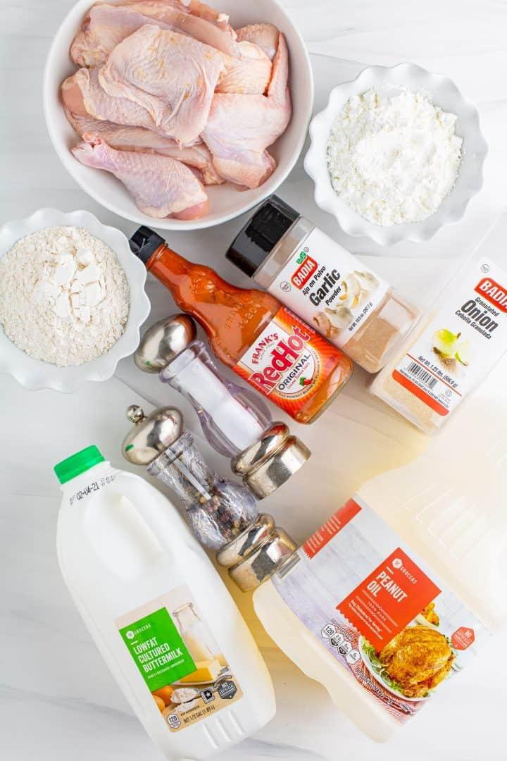 Ingredients needed to make The Best Southern Fried Chicken: chicken, salt, garlic powder, onion powder, buttermilk, hot sauce, flour, cornstarch, black pepper.