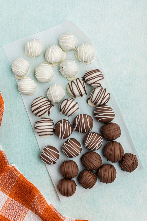 Guinness Cake Balls on parchment paper drizzled with chocolate