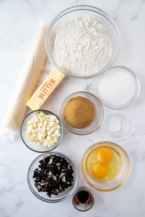 Ingredients needed to make Oreo Cookie Pie: refrigerated pie crust, unsalted butter, brown sugar, granulated sugar, eggs, vanilla extract, salt, all-purpose flour, Oreo cookies, white chocolate chips