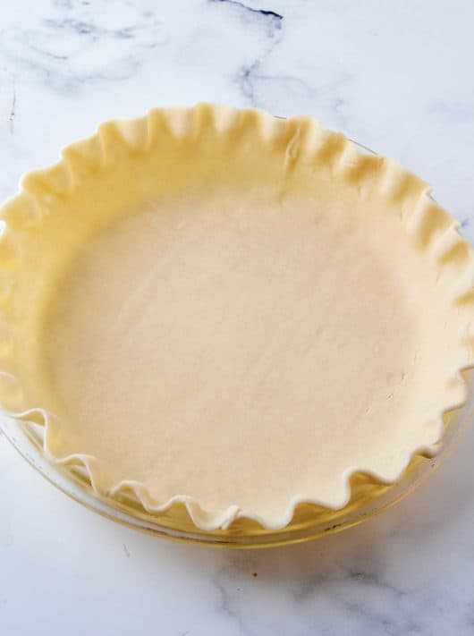 Pie crust in pie plate with edges fluted