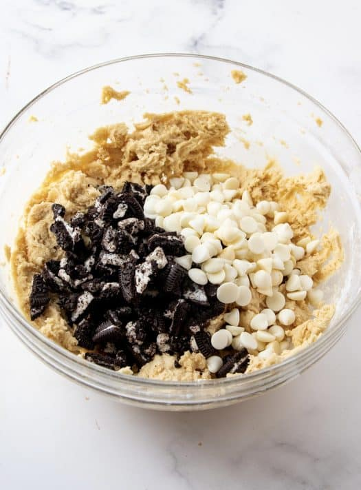 White chocolate chips and chopped up Oreos added to dough