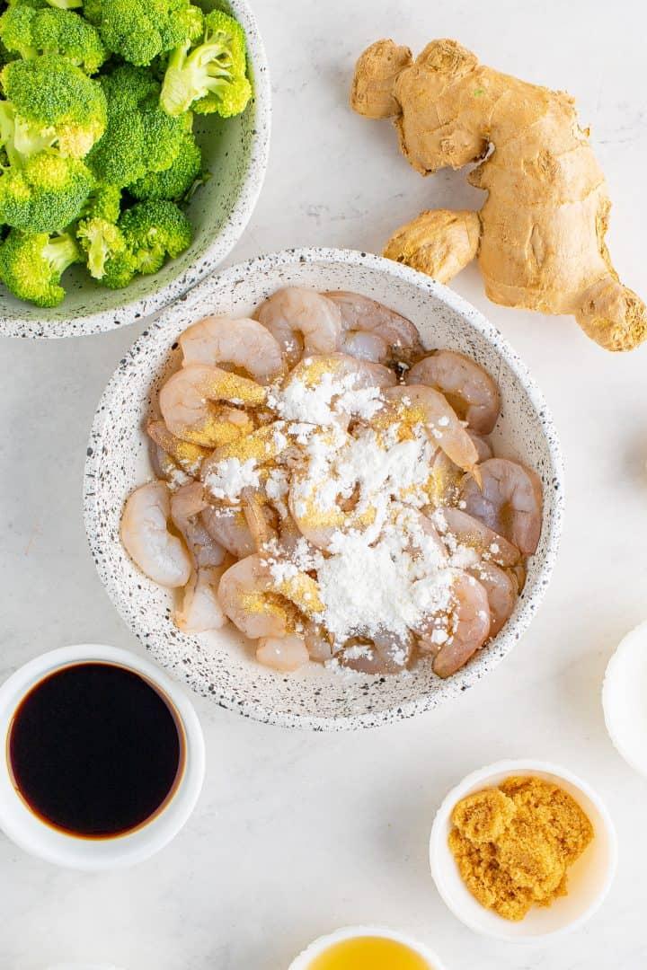 Shrimp in bowl with cornstarch and garlic powder