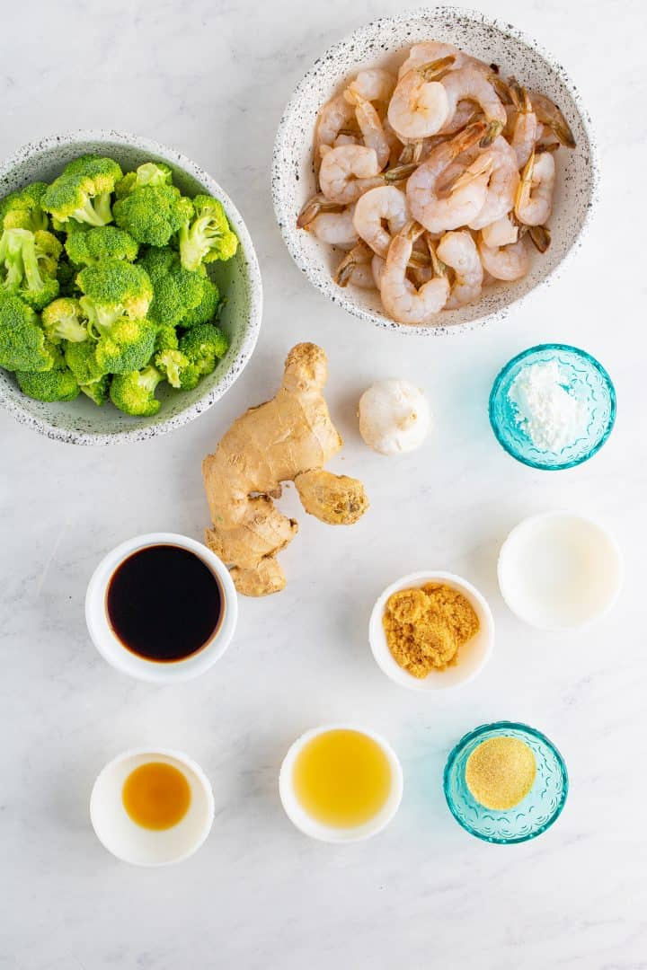 Ingredients needed to make One Pan Shrimp and Broccoli: shrimp, cornstarch, garlic powder, soy sauce, chicken stock, garlic, brown sugar, cornstarch, white vinegar, ginger, sesame oil, vegetable oil, broccoli florets, water