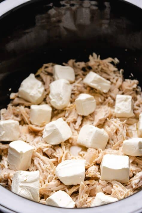 Cubed cream cheese added to crock pot
