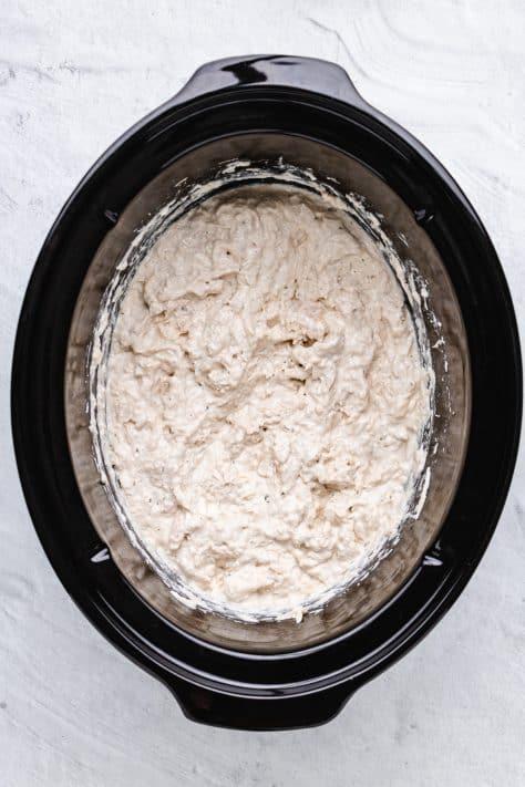 Cream cheese mixture stirred into shredded chicken