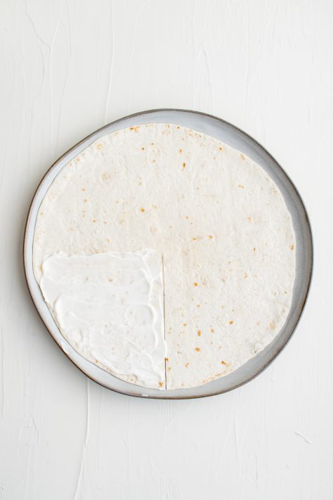 Tortilla on plate with slit cut in it