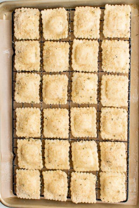 Coated ravioli on wire rack