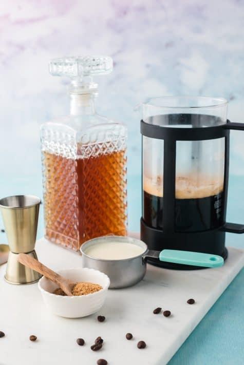 Ingredients needed to make Old-Fashioned Irish coffee: brewed coffee, Irish whiskey, brown sugar, heavy cream