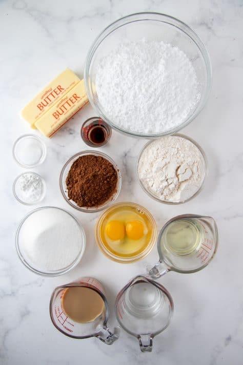 Ingredients need to make Homemade Baileys Cupcakes: all-purpose flour, sugar, cocoa powder, baking powder, baking soda, salt, vanilla extract, eggs, Baileys Irish Cream, water, oil, butter, powdered sugar