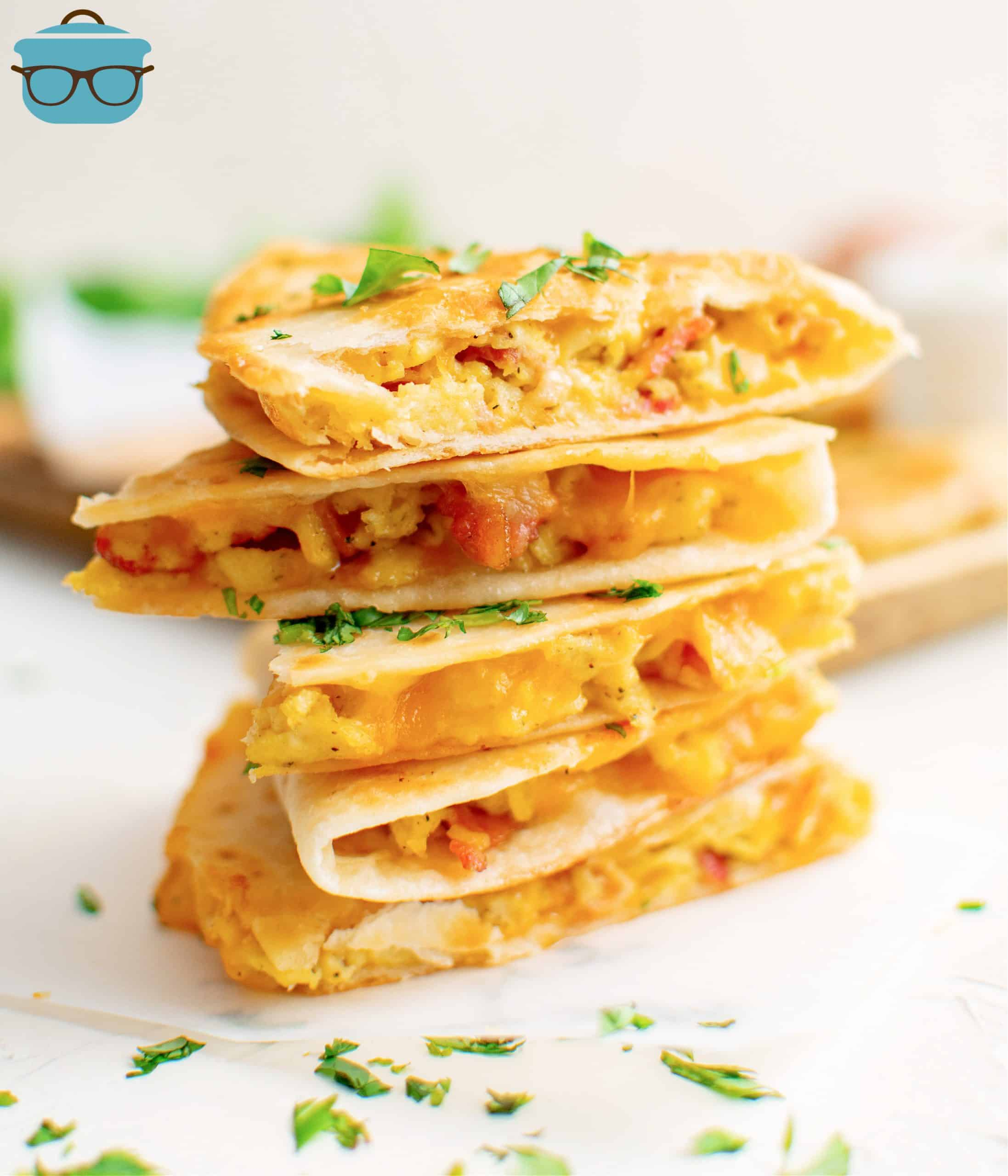 Breakfast Quesadillas cut in half and stacked in pile.