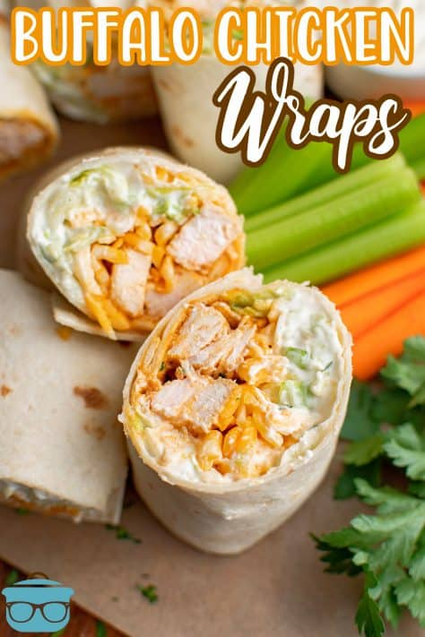 One cut open Buffalo Chicken wrap next to carrots and celery Pinterest Image
