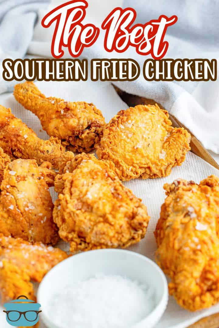 fried chicken pieces shown on a paper towel with a small bowl of sea salt to the side.
