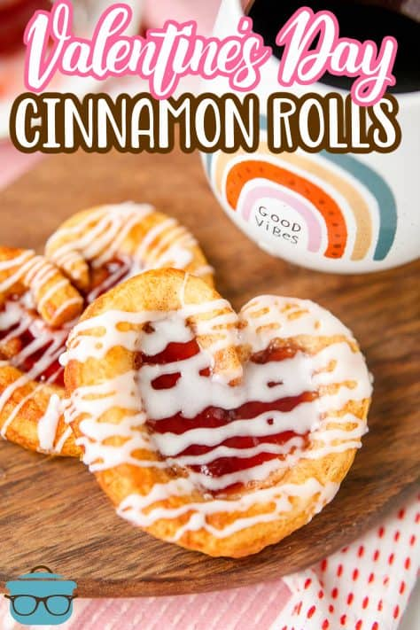 Valentine's Day Cinnamon Rolls recipe from The Country Cook: two stacked Valentine's Day Cinnamon Rolls on brown platter