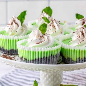 Close up of Mini Mint Chocolate Cheesecakes on cake stand thumbnail image