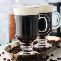 Old-Fashioned Irish Coffee on platter with coffee beans square image