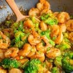 Close up of Shrimp and Broccoli in pan with serving spoon square image